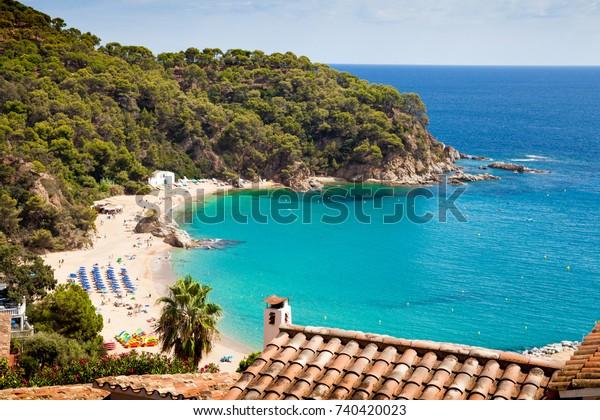 Top view of platja de canyelles beach. Beautiful beach and harbor between the cities of Lloret de mar and Tossa de mar.