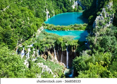 Top view of Plitvice Lakes with waterfalls and surrounding forest