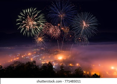 Top view point of Mae Hong Sorn Thailand in the morning and evening, Wat Pra Trad Doi Kong Moo landmark location, Fire work of celebration.