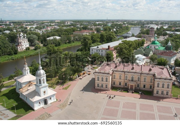 Top view from the view point on Vologda, river, boats, buildings, churches, square in sunny summer day