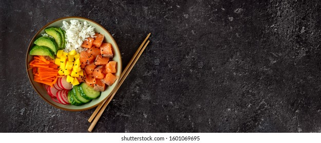 Top view of poke bowl with salmon and avocado on dark background - Shutterstock ID 1601069695