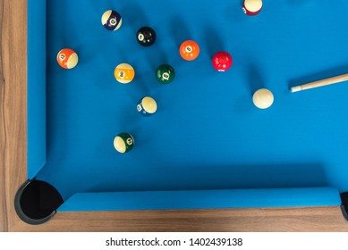 top view of pool or billiards balls on light blue table