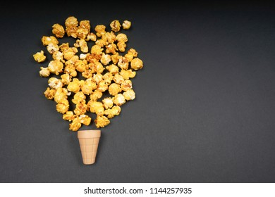 Top view of Pop Corn with ice cream cone on black background