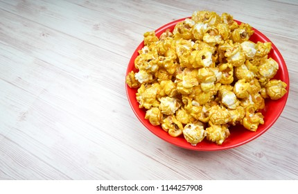 Top view of pop corn on wooden table