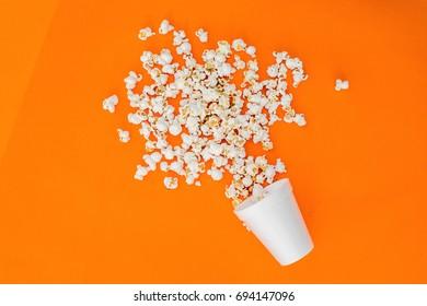 top view pop corn in vase.Orange background