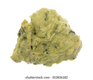 Top view of a portion of freshly made packaged spinach hommus isolated on a white background.