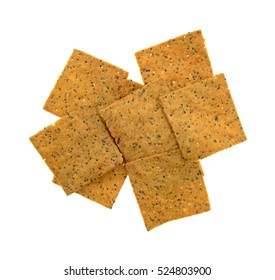 Top view of a portion of gourmet teff whole grain snack crackers isolated on a white background.