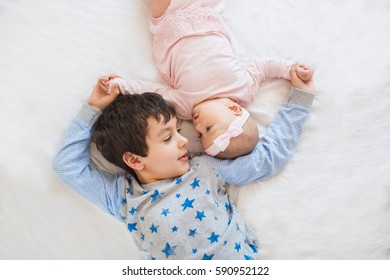 TOP VIEW: Portrait of cute brother with his little sister