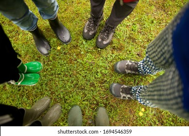 Top view portrait group of people standing on grass with hiking boots