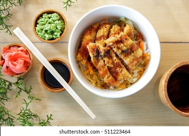top view portrait of japanese food chicken katsu don served with soy sauce on wooden table