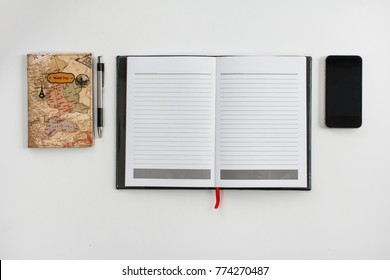 top view portrait of mock up of notebook, pen, and mobilephone on white background