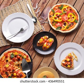 top view portrait of some homemade italian cuisine on wooden table ready to eat