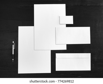 top view portrait of white stationery mock up, template for branding identity on black background