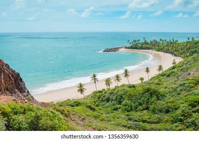 Top view of Praia de Coqueirinho at Costa do Conde. Photo taken at Mirante Dedo de Deus belvedere. Conde PB, Brazil. View of a northeastern Brazilian beach, the sea and nature around.