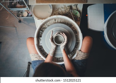 Top View of Professional Pottery Maker Works in Own Clay Studio on Pottery Wheel Makes Future Flowerpot or Beautiful Vase