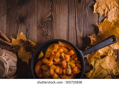Top view of pumpkin and wooden background