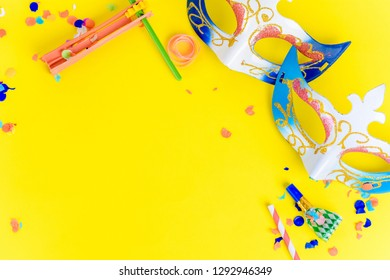 Top view of Purim background with carnival mask and party costume. Purim celebration concept
