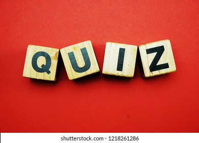 top view quiz letters alphabet wooden cubes on red background
