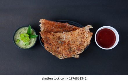 Top View of Rava dosa with 2 chutny shoot in Black background High quality image - Shutterstock ID 1976861342