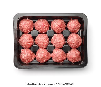 Top view of raw beef meatballs in plastic tray isolated on white