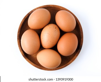 Top view of raw brown eggs on wooden plate isolated on white background. Eggs are a common ingredient in cooking.  Egg protein is a protein that can be absorbed efficiently. Food concept.
