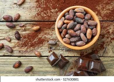 top view raw cocoa beans in ceramic bowl rustic background