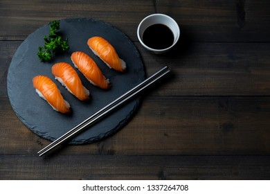Top view of raw fresh salmon sushi japanese food with copy space