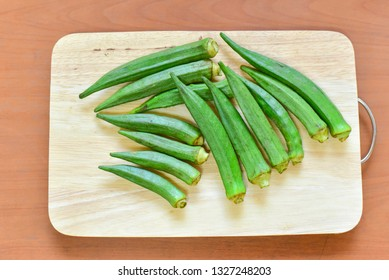 Top View of Raw Okra on Wooden Board