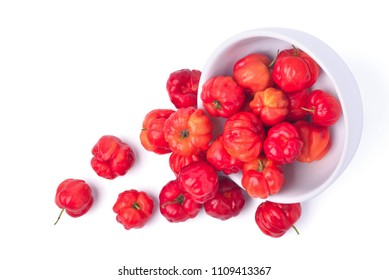 Top view of Red Acerola cherry in white bowl isolated on white background, High vitamin C and Antioxidant fruits