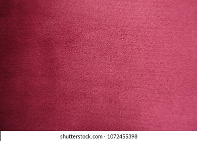 Top view of red artificial suede fabric