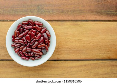 Top view of red beans in white bowl on wooden with copy space. Healthy and nutrition food concept,cooking concept.