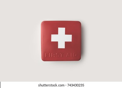 Top view of red firs-aid kit with white cross isolated on white