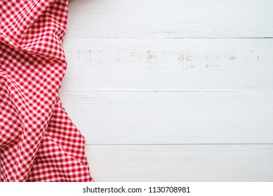 Top view of red napkins on white wooden table background - Food and kitchen concept