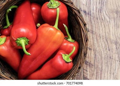top view of red peppers in basket