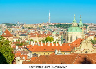Top view to red roofs and green trees skyline of Prague city Czech republic.