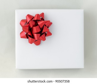 Top view of Red star ribbon on White paper box, Gift for Special Day