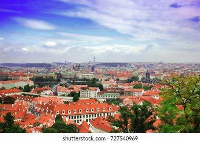Top view to red tile roofs of Prague city Czech republic. Typical Prague houses. Wide angle panorama.