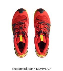 Top view of red trail running shoes isolated on white background