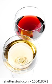 top of view of red and white wine glasses on white background