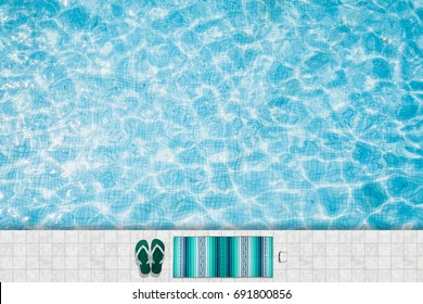 Top view of a refreshing turquoise swimming pool with towel and flops