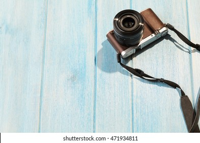 top view of retro style camera on blue wooden table