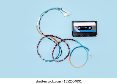 Top view retro tape cassette with colourful earphone. Love music concept