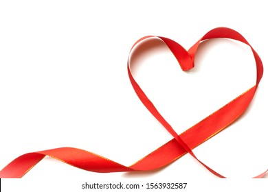 Top view of ribbon shaped as heart isolated on white background. Valentine's day concept