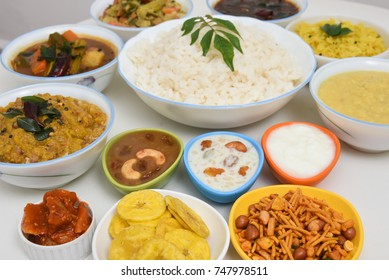 Top view of rice and curry Indian Thali vegetarian food arranged for feast on harvest festival Onam Kerala India.