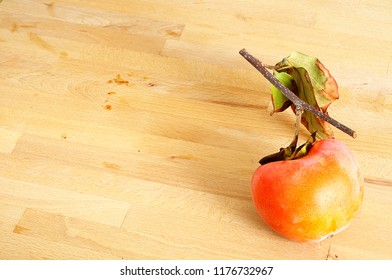 top view of ripe organic kaki on wooden background. The high content of the beta-carotene, and zeaxanthin, along with some lutein and alpha-carotene makes the kaki fruit nutritionally valuable