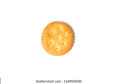 Top view of round salted cracker cookie isolated on white background.