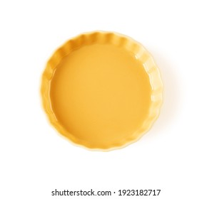 Top view of round yellow ceramic plate with wavy edge isolated on a white background. Empty crockery for food design. Modern stylish dishes and tableware made of clay, ceramics and porcelain. Close-up
