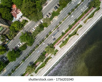 Top view of Roxas Boulevard and boardwalk, fronting Manila Bay. Coastal avenue in the capital of the Philippines. Diagonal composition.