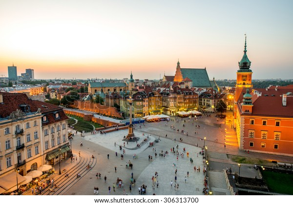Top view of Royal castle and old town crowded with people in Warsaw on the evening