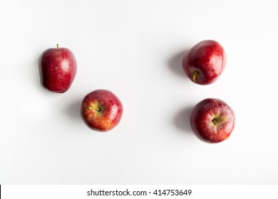 Top view of Royal Gala apples on white background.